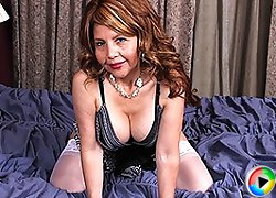 Naughty American cougar purring on her bed
