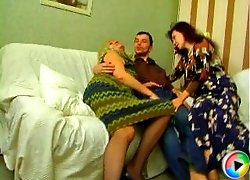 Horny Genadi having groupsex fun with two mature gals - blonde Irina and brunette Maria. Gals stuff each