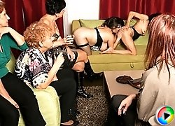 Old and young lesbians perform in a room full of mature ladies