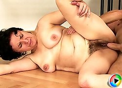 She gives him a great granny blowjob and then he jerks off onto her face and cums hard