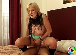 Hardcore sex with the gorgeous granny hooker makes him a very happy man